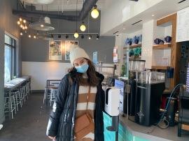 Me at Bluestone Lane coffeeshop in DC